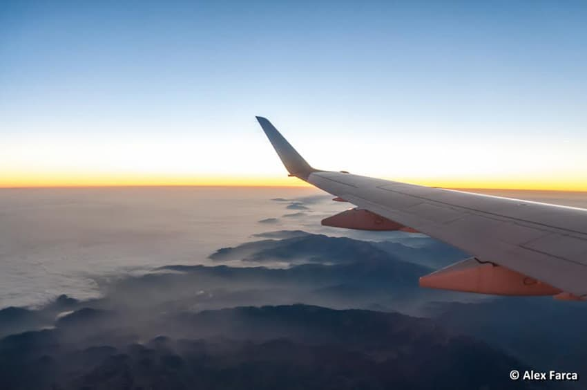 sunrise over himalayan mountains. 20 Views from a Plane Window