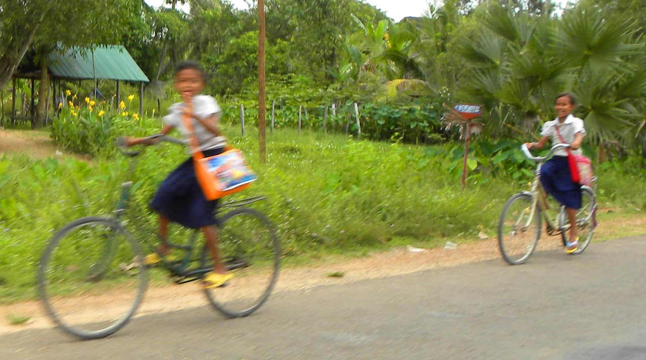 kids on bikes. Photos of Faces and everyday life in Cambodia