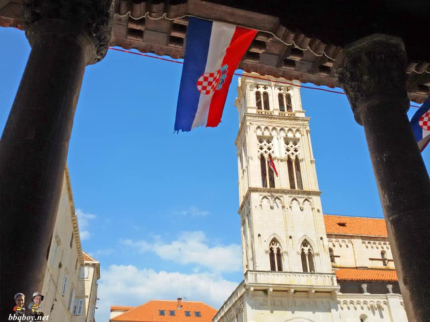 Croatian flag at City Loggia with St. Lawrence Cathedral in the background
