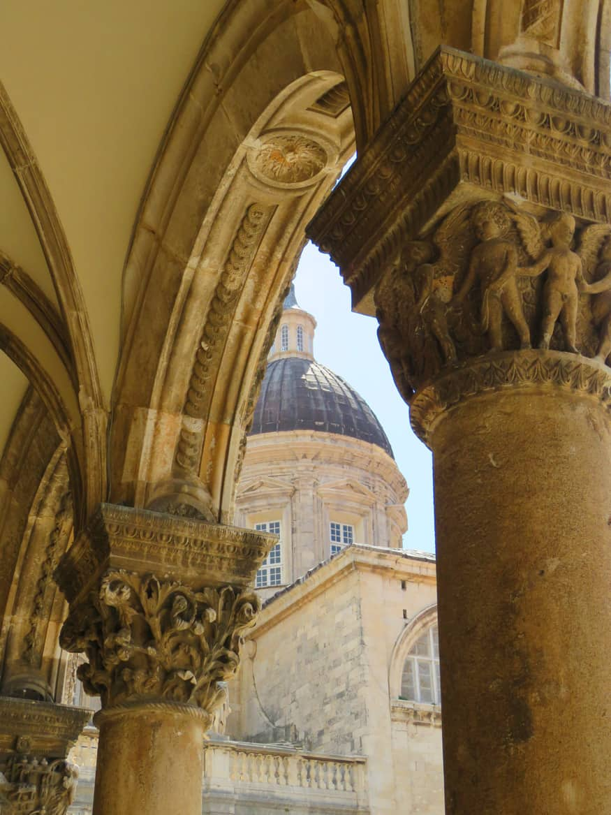 views of Cathedral through arches of Rectors Palace, Dubrovnik Croatia