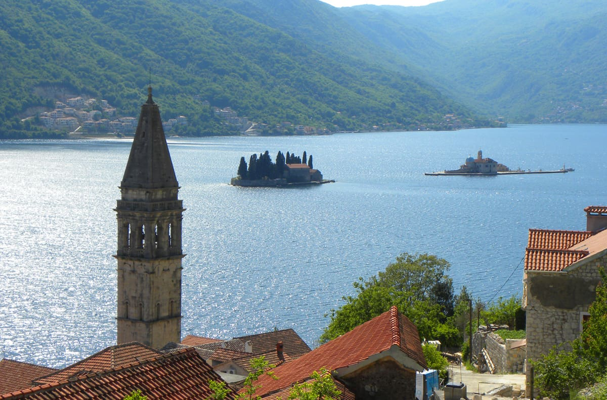Views of the two man-made islands of Abbey of St. George (left) and Our Lady of the Rock (right). The stunning beauty of Kotor Bay in Perast, Montenegro