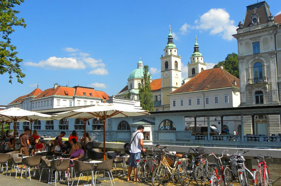 Views across the river towards St. Nicolas Church and the Central market. A Visit to the Charming City of Ljubljana
