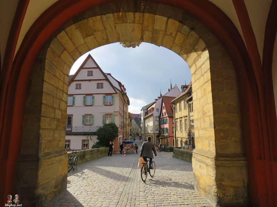 views of old town Bamberg through the arch of the Rathous