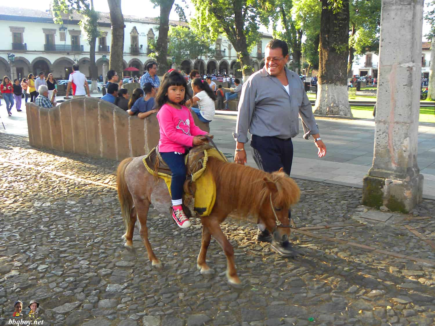 girl on pony, plaza grande, patzcuaro