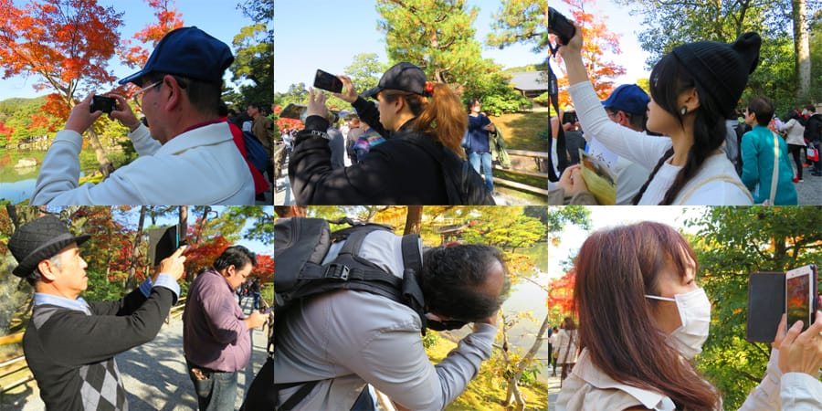 whole bunch of people taking photos in Kyoto. Are we all just photo-clicking monkeys? What's travel about?