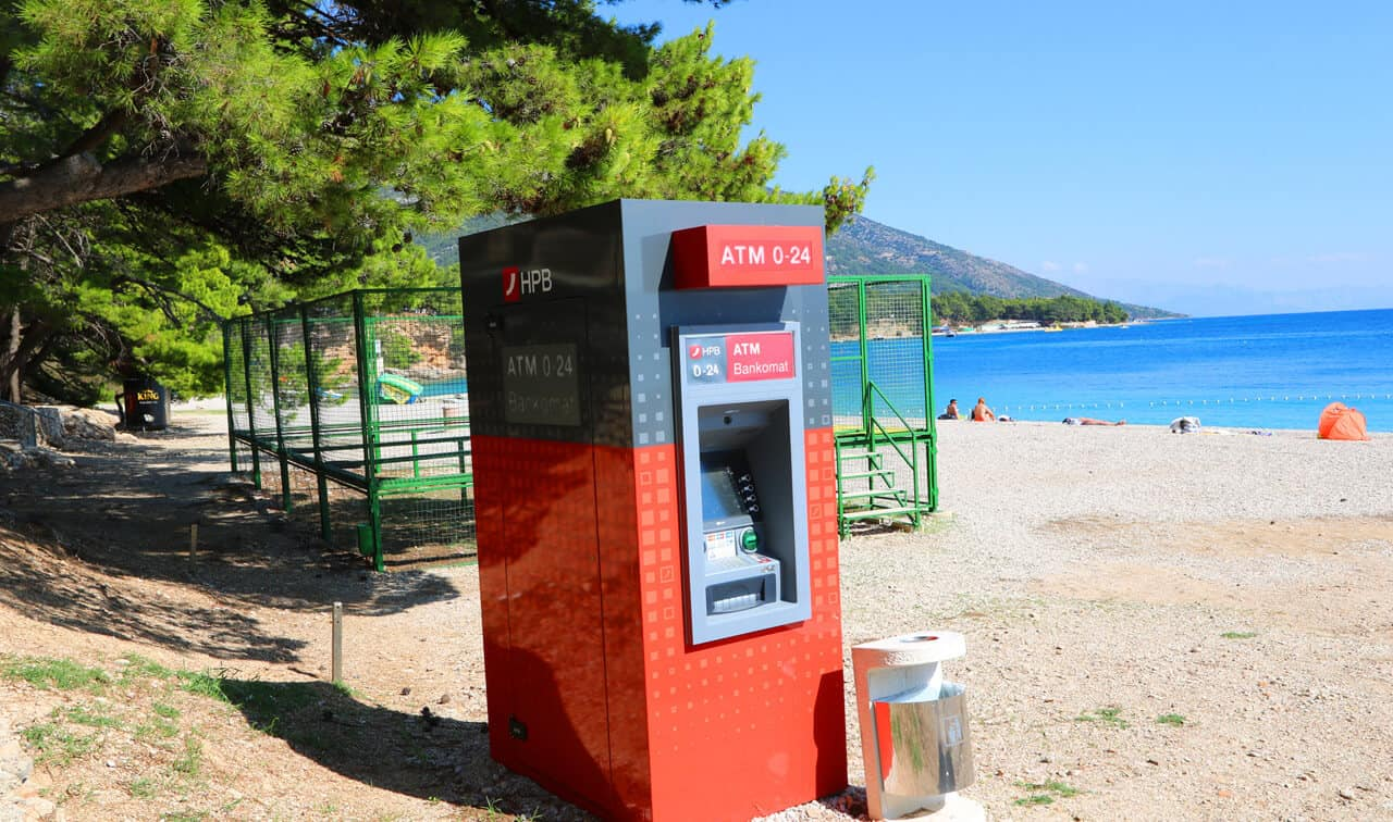 ATM on Zlatni Rat beach, Brač Island, Croatia
