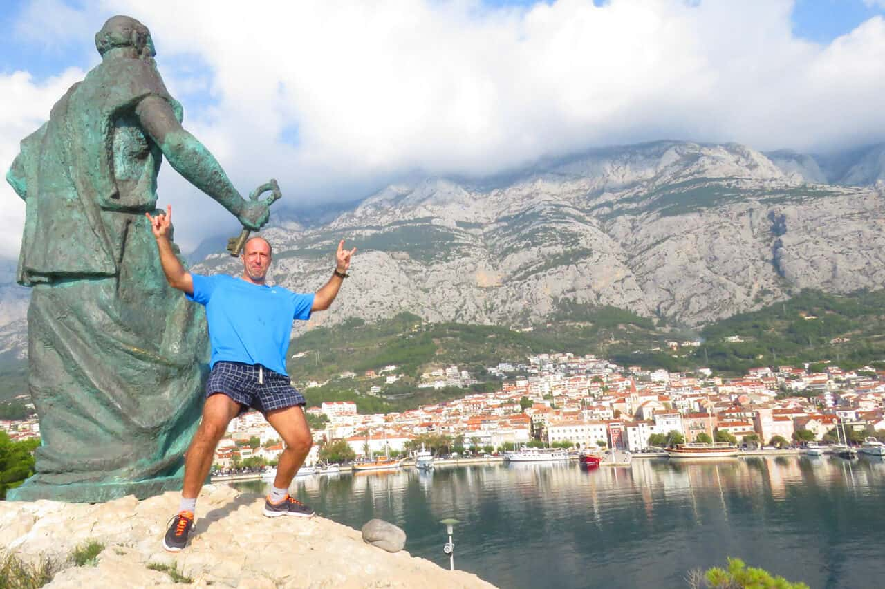 posing by the statue of St. Peter, Makarska