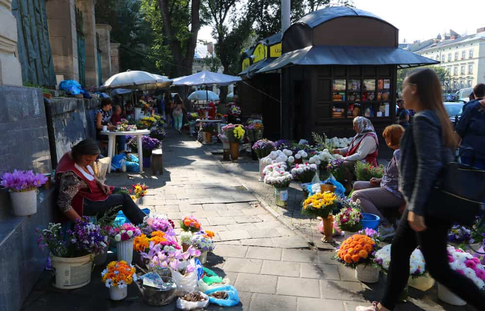 ladies selling flowers at the market in Lviv. Why we loved our Summer in Lviv (in photos)
